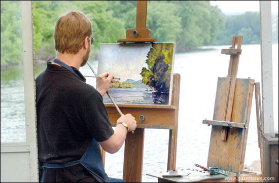 6-20-06 dsc 2565 Hadley  Bryden paints aboard his floating studio---easel on right holds his pallete