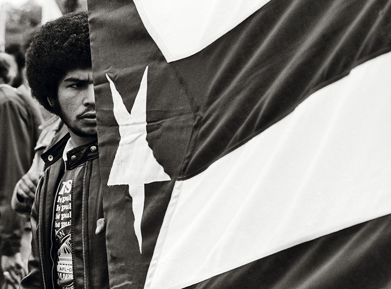 Young Man With Puerto Rican Flag, Photograph