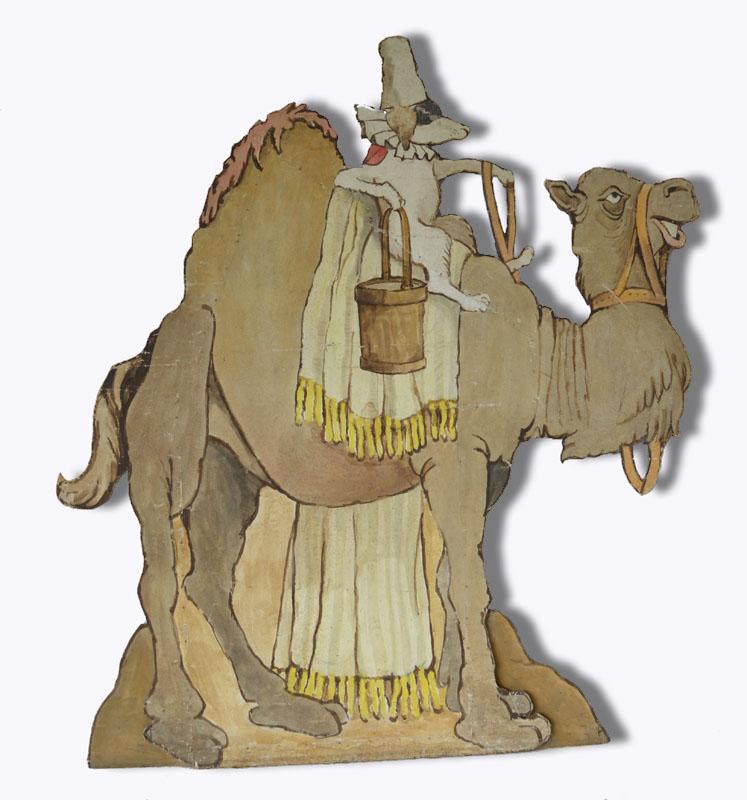 Dog Riding Camel